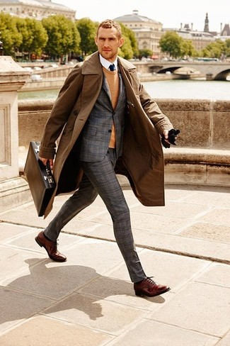 A brown coat and a grey tartan wool suit will showcase your sartorial self. Polish off the ensemble with burgundy leather oxford shoes. On not so cold afternoons, work this transitional outfit and look absolutely awesome.