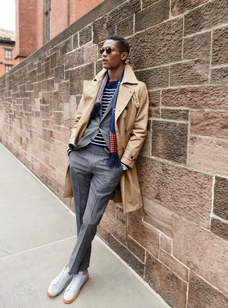 How to wear: tan trenchcoat, grey check suit, navy and white horizontal striped crew-neck sweater, white leather low top sneakers