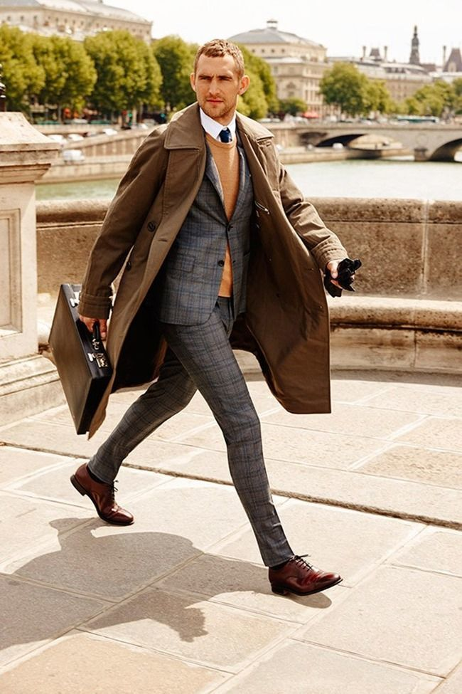 This combination of a camel round-neck sweater and a grey plaid wool suit  oozes