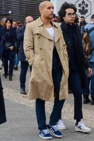 Navy Socks Outfits For Men: A tan trenchcoat and navy socks are the kind of a winning casual outfit that you so terribly need when you have no time to pick out a look. When it comes to shoes, this outfit pairs nicely with navy and white canvas low top sneakers.