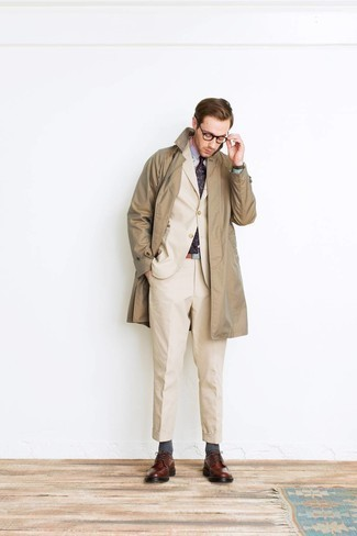 Tie Outfits For Men: This polished combo of a tan trenchcoat and a tie is undoubtedly a statement-maker. Add a more informal twist to an otherwise mostly dressed-up look with a pair of brown leather brogues.