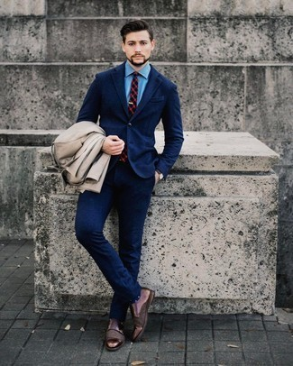 Beige Trenchcoat Outfits For Men: This combo of a beige trenchcoat and a navy wool suit embodies rugged elegance. You can go down a more casual route on the shoe front with a pair of dark brown leather double monks.