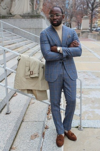 How to Wear a Light Blue Suit: A light blue suit and a beige trenchcoat are among the fundamental elements of any elegant wardrobe. And if you wish to effortlessly tone down this ensemble with a pair of shoes, complete this look with a pair of brown suede tassel loafers.