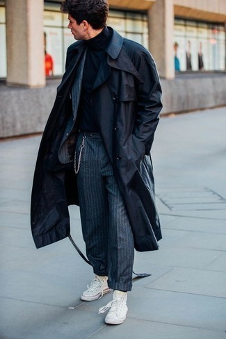 High Top Sneakers with Suit Outfits: Indisputable proof that a suit and a navy trenchcoat are amazing when teamed together in a polished outfit for a modern dandy. Does this ensemble feel too polished? Let a pair of high top sneakers change things up a bit.