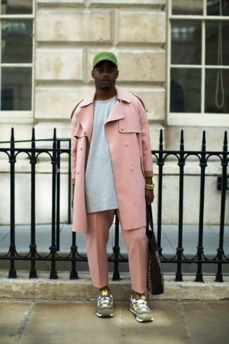 How to wear: pink trenchcoat, grey sweatshirt, pink chinos, olive suede athletic shoes