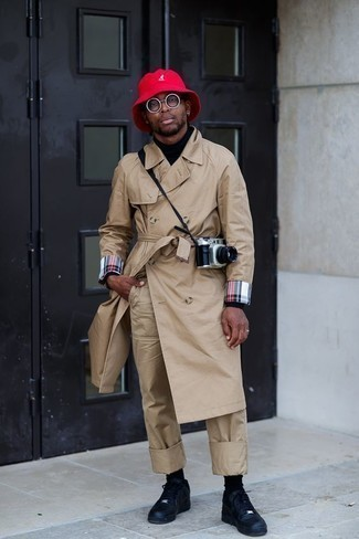 How to Wear a Tan Trenchcoat For Men: This look with a tan trenchcoat and khaki chinos isn't a hard one to score and easy to change. Introduce a pair of black leather high top sneakers to your look to easily dial up the street cred of your ensemble.