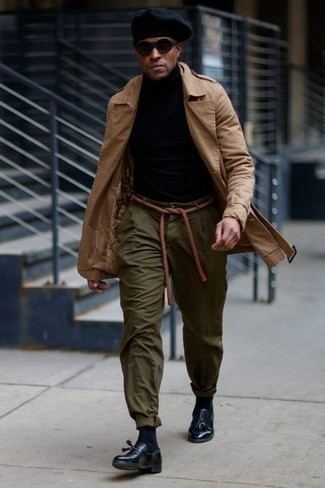 How to Wear a Tan Trenchcoat For Men: Such essentials as a tan trenchcoat and olive chinos are an easy way to introduce some masculine sophistication into your day-to-day off-duty lineup. When it comes to footwear, go for something on the classier end of the spectrum and finish off this outfit with black leather tassel loafers.