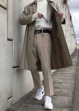 Beige Trenchcoat Outfits For Men: A beige trenchcoat and beige chinos are among the key items in any modern man's great wardrobe. To infuse a more laid-back spin into this look, introduce a pair of white and black athletic shoes to the equation.
