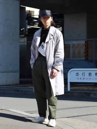 Grey Trenchcoat Outfits For Men: This combo of a grey trenchcoat and olive chinos looks polished, but in a modern way. Finishing with white leather low top sneakers is the most effective way to infuse a little edge into your ensemble.
