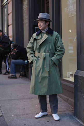 Hat Outfits For Men: This is solid proof that an olive trenchcoat and a hat are amazing when paired together in a street style look. A pair of white canvas low top sneakers is a good idea to finish this look.