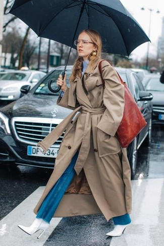 How to wear: tan trenchcoat, white and blue horizontal striped turtleneck, blue flare jeans, white leather ankle boots