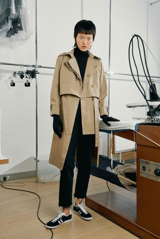 How to wear: tan trenchcoat, black turtleneck, black jeans, black and white canvas low top sneakers