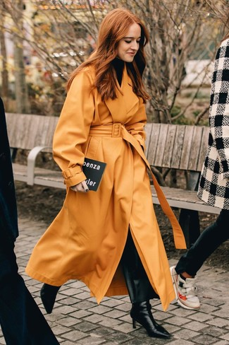 How to wear: orange leather trenchcoat, black turtleneck, black leather wide leg pants, black leather ankle boots