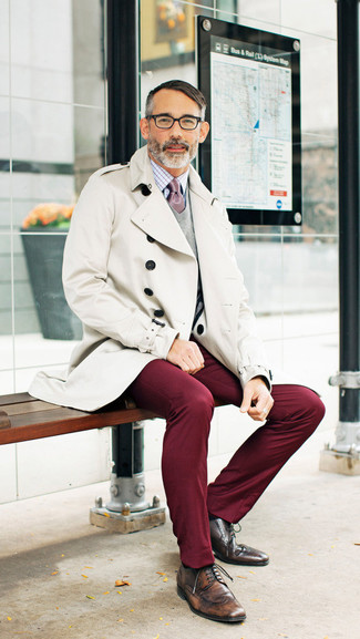 How to wear: beige trenchcoat, grey v-neck sweater, white and red check dress shirt, burgundy chinos