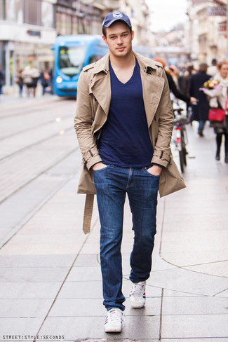 Men's Tan Trenchcoat, Navy V-neck T-shirt, Navy Jeans, White and Red and Navy Horizontal Striped Low Top Sneakers