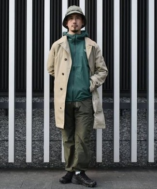 Beige Trenchcoat Outfits For Men: For an effortlessly classic look, wear a beige trenchcoat and olive cargo pants — these items play nicely together. Why not introduce black athletic shoes to the equation for an easy-going touch?