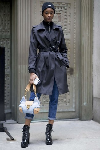 How to wear: black trenchcoat, black zip neck sweater, blue boyfriend jeans, black leather lace-up ankle boots