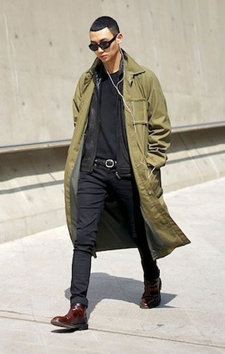 How to wear: olive trenchcoat, black zip sweater, black crew-neck t-shirt, black skinny jeans