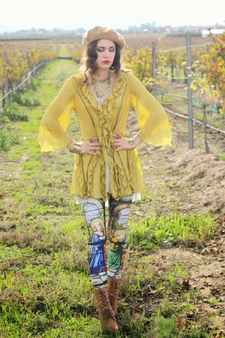 How to wear: yellow tunic, multi colored print leggings, brown leather lace-up ankle boots, tan beret
