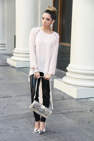 For an outfit that provides comfort and style, try teaming a dusty pink silk tunic with black leather leggings. To add oomph to your ensemble, round off with metallic leather pumps. We love this one, especially for springtime.