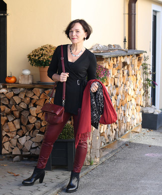 How to wear: black tunic, burgundy leather skinny pants, black leather ankle boots, burgundy leather crossbody bag