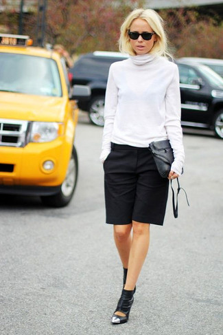 How to wear: white turtleneck, black bermuda shorts, black cutout leather ankle boots, black leather crossbody bag