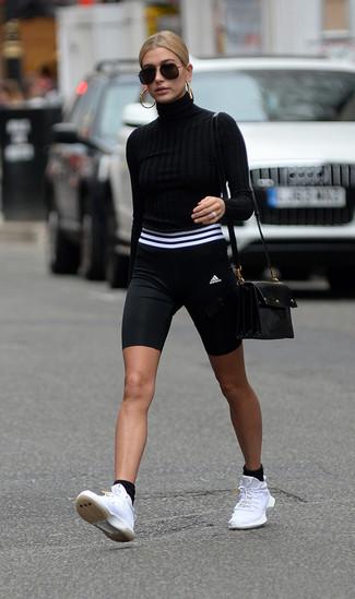 How to wear: black turtleneck, black and white bike shorts, white athletic shoes, black leather crossbody bag