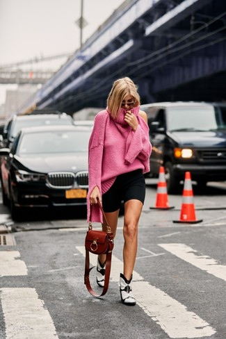 How to wear: hot pink knit turtleneck, black bike shorts, white and black leather cowboy boots, brown leather crossbody bag
