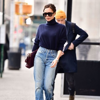 How to Wear a Navy Turtleneck For Women: Team a navy turtleneck with light blue boyfriend jeans to pull together a seriously stylish getup.