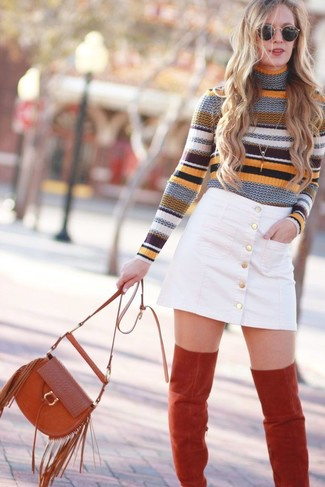 How to Wear a Multi colored Horizontal Striped Turtleneck For Women: For To pull together a casual outfit with a twist, choose a multi colored horizontal striped turtleneck and a white denim button skirt. And if you want to easily kick up this getup with one single piece, why not complete your look with red suede over the knee boots?