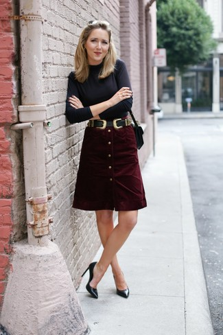 Try teaming a black turtleneck with a button skirt for a standout ensemble. Take a classic approach with the footwear and throw in a pair of black leather pumps. You can be certain this look is perfect for fluctuating fall weather.