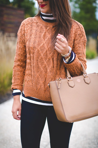 How to wear: navy and white horizontal striped turtleneck, tan cable sweater, black skinny jeans, tan leather tote bag