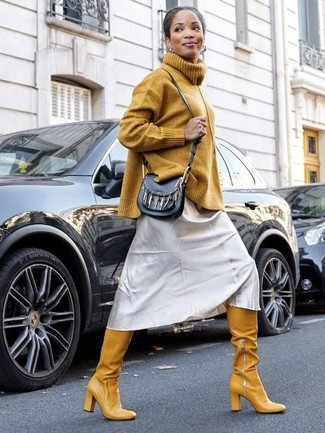 How to Wear a Mustard Knit Turtleneck For Women: If you're in search of an off-duty and at the same time incredibly stylish outfit, consider wearing a mustard knit turtleneck and a silver cami dress. Look at how well this getup pairs with mustard leather over the knee boots.