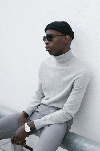 How to wear: grey turtleneck, grey chinos, black beanie, black sunglasses