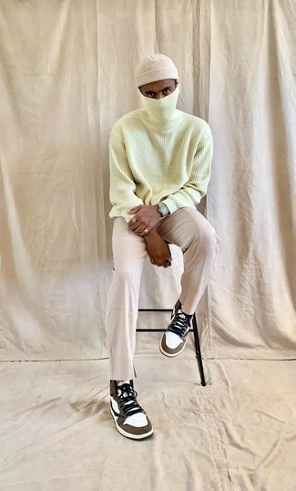 White and Brown High Top Sneakers Outfits For Men: If the situation allows a laid-back outfit, go for a mint wool turtleneck and beige chinos. To give this outfit a more casual touch, why not add a pair of white and brown high top sneakers to this getup?
