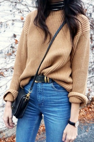 How to wear: black and white horizontal striped turtleneck, tan crew-neck sweater, blue skinny jeans, black leather crossbody bag