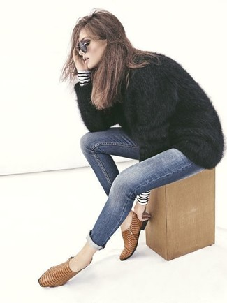 If you're a fan of classic pairings, then you'll like this combination of a black fluffy crew-neck sweater and navy skinny jeans. A cool pair of tan snake leather ankle boots is an easy way to upgrade your look. You can bet this getup is the answer to all of your transitional wear problems.
