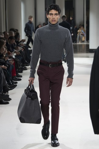 How to wear: charcoal wool turtleneck, dark purple dress pants, black leather monks, grey leather holdall