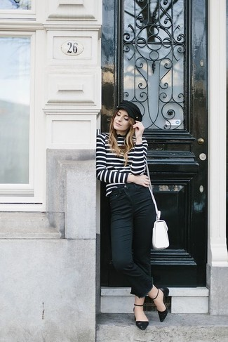 If you're a fan of classic pairings, then you'll like this pairing of a black and white horizontal striped turtleneck and black jeans. Why not add ballerina shoes to the mix for a more relaxed feel? We guarantee this ensemble is the answer to all of your transitional dressing problems.