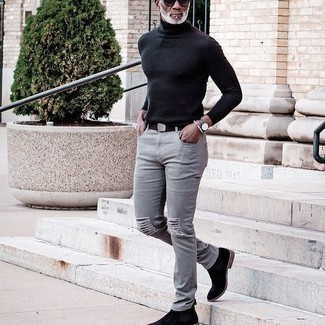 Black Suede Chelsea Boots Outfits For Men: If you're in search of a casual street style yet sharp ensemble, try teaming a black turtleneck with grey ripped jeans. For a more refined take, why not complement your ensemble with a pair of black suede chelsea boots?