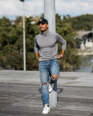 Blue Ripped Jeans Outfits For Men: A grey turtleneck and blue ripped jeans are a savvy combination to have in your daily off-duty wardrobe. Go ahead and complement your ensemble with white canvas low top sneakers for a dash of class.