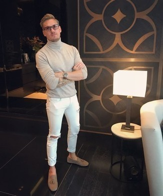 How to Wear a Beige Turtleneck For Men: If you're a jeans-and-a-tee kind of guy, you'll like this low-key combination of a beige turtleneck and white ripped jeans. Puzzled as to how to finish your ensemble? Wear a pair of tan suede tassel loafers to smarten it up.