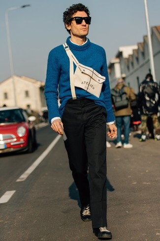 How to wear: teal wool turtleneck, white long sleeve shirt, black chinos, black leather low top sneakers