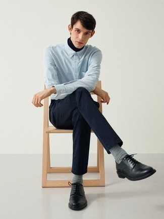 Shirt Outfits For Men: This pairing of a shirt and navy chinos makes for the perfect base for a cool and casual ensemble. Black leather derby shoes are an effective way to add a little kick to the ensemble.