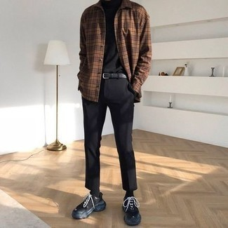 500+ Fall Outfits For Men: Pair a black turtleneck with black chinos to feel fully confident in yourself and look casually cool. Black athletic shoes are a guaranteed way to give an air of stylish casualness to this look. You can bet this getup will become your go-to when chillier weather comes.