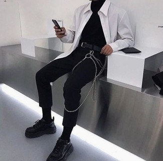 500+ Casual Outfits For Men: This combo of a black turtleneck and black chinos is an interesting balance between laid-back and stylish. Finishing off with black athletic shoes is an effective way to inject a carefree feel into your outfit.