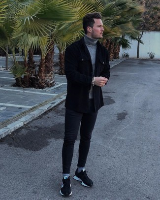 Black Skinny Jeans Outfits For Men: Effortlessly blurring the line between sharp and casual, this pairing of a grey turtleneck and black skinny jeans will likely become one of your go-tos. Complement your outfit with a pair of black and white athletic shoes to avoid looking overdressed.
