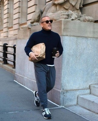 Navy Turtleneck Outfits For Men: This combination of a navy turtleneck and navy sweatpants spells comfort and fashion. Does this outfit feel all-too-perfect? Let a pair of navy and white athletic shoes change things up a bit.