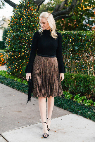 How to wear: black turtleneck, brown pleated midi skirt, black embellished suede heeled sandals, black fringe suede clutch