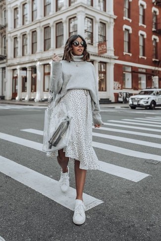 How to wear: grey knit turtleneck, white and black polka dot midi skirt, white leather low top sneakers, clear rubber tote bag